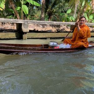 On day one we decided to abandon our group and go visit the floating market in Bangkok.  We went by boat and as you can see past a monk rowing his way down the waterway.