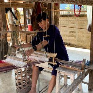 Silk weavers at work.